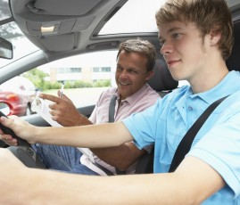 Teenage Boy Taking A Driving Lesson